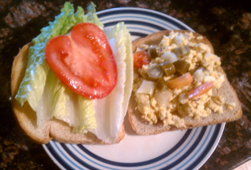 Spicy Egg Salad Sandwich (serves 3-4) Ingredients: 4 Eggs, Boiled and Chopped 1/4 cup Onion, Minced 2 Tsp. of Mustard 3 Tsp. of Mayo  1 Tsp. of Paprika  Salt and Pepper to taste Whole Wheat Bread (toasted) Optional: 1 Medium-sized Tomato  Romaine Lettuce Giardiniera Peppers Horse Radish Mustard How to Make It 1. In a bowl, mix eggs, onion, mustard, mayo, paprika, salt and pepper. The mixture should be fairly dry. If the mixture is more liquid, refrigerate for a few hours. 2. Spread the mixture on toast, add giardiniera peppers (to taste), a couple slices of tomato, lettuce, and horse radish mustard. 3. Enjoy!