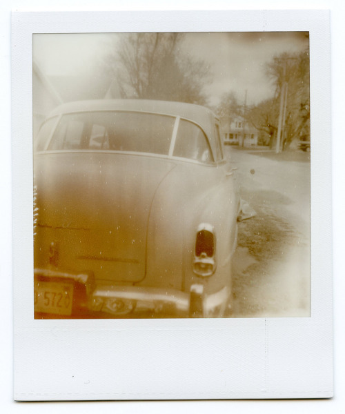 Automobiles in Proximity One. Polaroid SX-70.