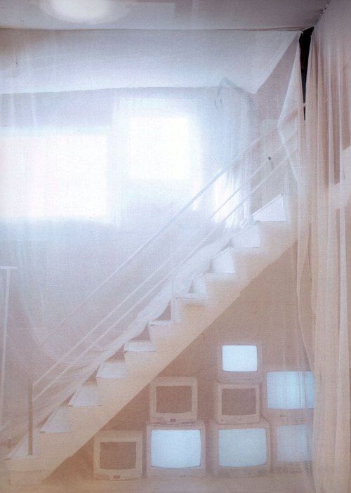 Margiela store that opened in Tokyo in 2006; tulle curtains in varying shades of white cover the walls and windows.