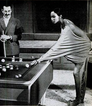 "Iconoclastic model Donyale Luna shoots pool with the legendary Groucho Marx in a scene from the film Skidoo in 1968. In the film, directed by Otto Preminger, Mr. Marx played ""God"" and Ms. Luna played his mistress. It's a long story."
