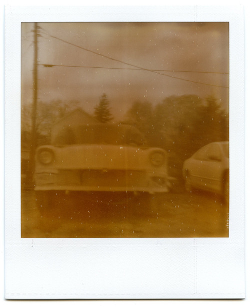 Automobiles In Proximity Two. Polaroid SX-70.