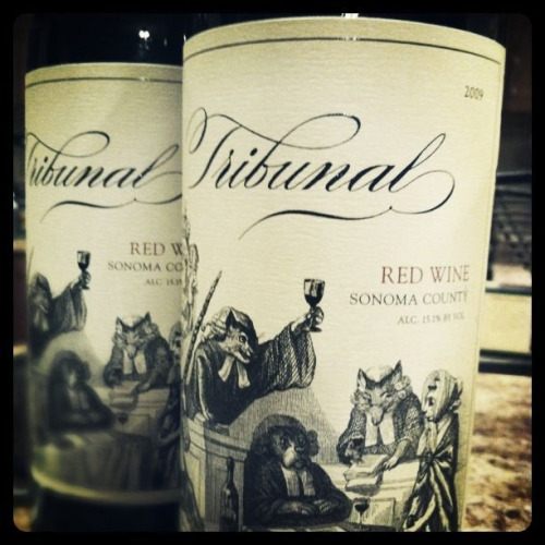 Tribunal 2009 Sonoma County Red Blend.  As you know, this week, the Saturday Night Supper Club has taken the show on the road.  This week I didn't cook, but I visited a new Trader Joe's in Peoria, AZ. We are out here on the outskirts of Phoenix for a long weekend visiting my cousin, her husband and two boys. To my surprise I found the hustle buy I had been looking for in California that sold out within a week in January, never to be seen again. Tribunal 2009 Red Blend from Sonoma County.  So there I am in the middle of Trader Joe's with my husband, 3 year old daughter and my 7 year old nephew, in the wine section, flipping out over the huge display of Tribunal innocently sitting there like it was not anything unusual. Wohoo!  I was very exited to finally taste this much hyped wine, reported to be a clone of Orin Swift's Prisoner, retailing at $9.99 - and how did if taste?  Let's start with the nose: French Oak, Vanilla, herbs, minerals, and a hint of red fruit, exploding onto the palate with lots of bold red fruit, awakening each individual taste bud in a rock band of flavor. The finish really rounds out the experience with notes of dry red fruit and subtle nuances of honey and anise.  So what is my suggestion? Grab it IF you see it. Grab multiple bottles and enjoy either with some cheese and crackers or just by itself. I will definitely be picking up some more before we head home.