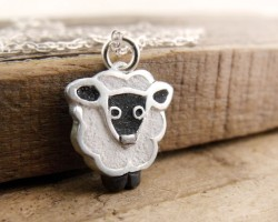 love these concrete necklaces especially this little sheep