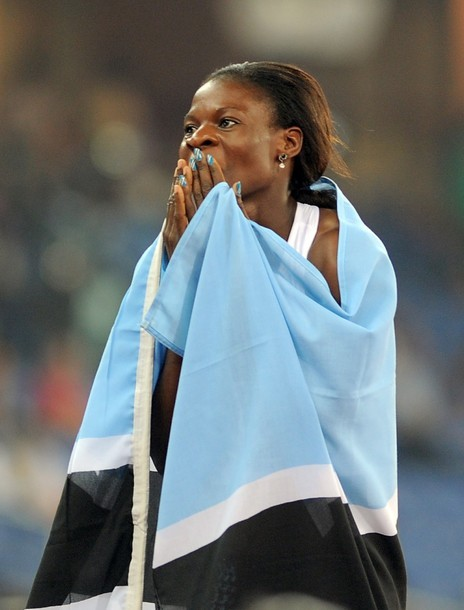 Botswana's Amantle Montsho celebrates her victory in the women's 400m final of the Track and Field competition of the XIX Commonwealth games (via Photo from Getty Images)