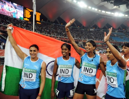 womenandsports:  India's Sini Jose, Ashwini Akkunji, Manjeet Kaur and Mandeep Kaur celebrate their win in the women's 4x400m relay final of the Track and Field competition of the XIX Commonwealth Games (via Photo from Getty Images)