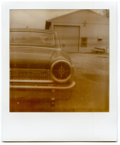 Automobiles In Proximity Three. Polaroid SX-70.