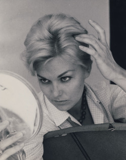 Kim Novak checks her hair on the set of Kiss Me, Stupid, 1964.