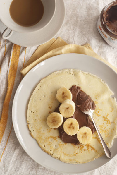 oohlalala:  Bananas and chocolate crepe in the making