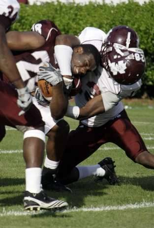 Vick Ballard running hard, also being tackled just as hard, during the MSU Spring Game