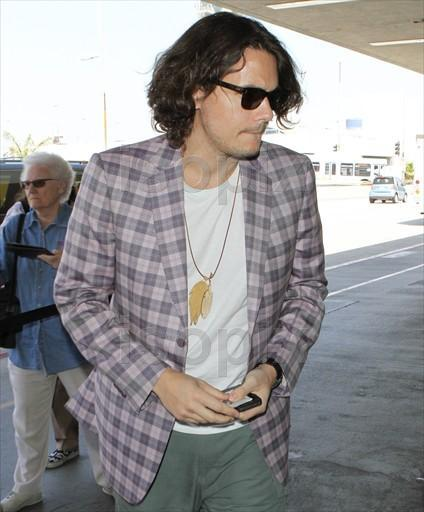NEW PICTURES! LAX, April 17, 2011 (sorry for the watermarks)