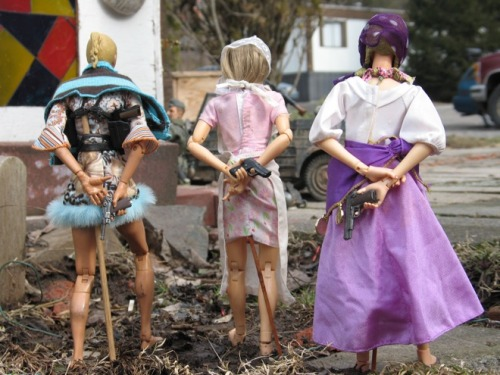 mabelmoments:  The beautiful but deadly women of Marwencol. Photo: Mark Hogancamp  A wedding takes place in front of strung-up S.S. infantry. Topless women bathe in a river and are discovered by a Nazi soldier. What appear to be oddball scenes from World War II staged with action figures are actually one man's attempt to rebuild his life. These images come from the mind of Mark Hogancamp, who was beaten and repeatedly kicked in the head by five men outside a bar in Kingston, New York eleven years ago. The attack was so brutal that afterwards his mother Edda did not recognize him. When Hogancamp emerged from a 9-day coma, he had no language, he could not walk and he could not eat without assistance. For twelve months, the ex-Navy man received state-sponsored physical and occupational therapy and regained many of his motor skills. Without medical insurance, however, Hogancamp was soon unable to afford the treatments. Lacking conventional rehabilitation, Hogancamp devised his own, unknowingly embarking on an art project that would be featured in high-profile exhibits and make him the subject of a hit indie documentary. [continued and gallery]   THIS. MOVIE. IS. AMAAAAAAAAAZING. So emosh, so surprising, sooo wonderful.
