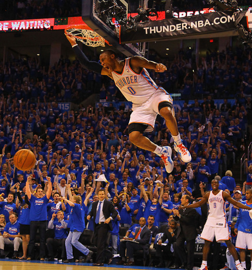 #0 bringing the Thunder.  thebeautyofsports:  Russell Westbrook #0 of the Oklahoma City Thunder dunks the ball after a turnover against the Denver Nuggets in Game One of the Western Conference Quarterfinals in the 2011 NBA Playoffs on April 17, 2011 at the Ford Center in Oklahoma City, Oklahoma. (via Sports Day In Pictures | Denver Post Media Center — Denver, Colorado, Photos and Video)