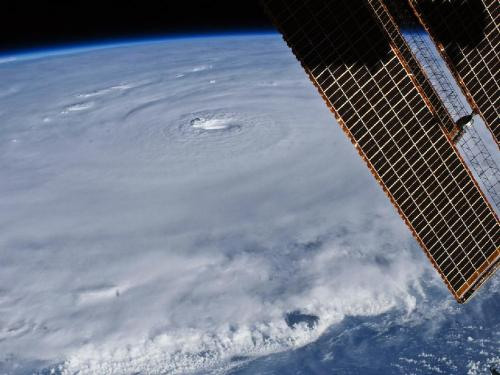 "Hurricane Earl: The Astronaut View  The relatively placid view from the International Space Station belied  the potent forces at work in Hurricane Earl as it hovered northeast of  Puerto Rico on Aug. 30, 2010. With maximum sustained winds of 135 miles  (215 kilometers) per hour, the storm was classified as a category 4 on  the Saffir-Simpson hurricane scale as it passed north of the Virgin  Islands. In this photograph captured with a digital SLR camera  by NASA astronaut Douglas Wheelock, Earl had a distinct eye that spanned  about 17 miles (28 kilometers). Most of the storm had a seemingly  uniform top, though the bottom edge of the image gives some sense of the  towering thunderheads forming over the ocean. The solar panels of the  ISS remind us that the sun is still shining, at least on ISS Expedition  24. ""Hurricane Earl is gathering some serious strength,""  Wheelock wrote from his perch on ISS. ""It is incredible what a  difference a day makes when you're dealing with this force of nature.  Please keep a watchful eye on this one…not sure if Earl will go  quietly into the night like Danielle."" (via NASA)"