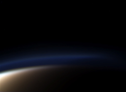 Is Titan Hiding an Ocean? — Saturn's moon Titan just keeps throwing surprises at us. A multi-layered atmosphere thicker  than our own? Check. A hydrologic cycle that relies on methane as the  operating liquid? Check. Rivers, streams and lakes filled with this same  liquid? Check, check and check. And now, scientists are suspecting that  Titan may have yet another surprise: a subsurface ocean.   Observations of Titan's rotation and orbit, carried out by researchers at the Royal Observatory of Belgium using Cassini data, point at an unusual rotational inertia; that is, its resistance  to changes in its motion, also known as moment of inertia or angular  mass. Basically Titan moves in a way that is not indicative of a solid  body of its previously assumed density and mass. Rather, its motion –  both around its own axis and in its tidally-locked orbit around Saturn – are more in line with an object that isn't uniformly solid. (via universetoday)