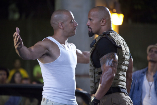 "Fast Five review Muscle cars driven by pec-flexing guys watched by girls in hotpants… you'd think the Fast And The Furious franchise would've run out of gas by now. Think again.This latest instalment, beginning immediately where the previous episode left off, is like The Avengers for F&F fans. With disparate characters from past episodes recalled to duty, it's like Dominic Torreto (Vin Diesel) says to now-pregnant sis Mia (Jordana Brewster): ""The family just got bigger."" Still, getting bigger is what this car-crunching franchise is all about – and on that score FF5 doesn't disappoint. Forget FF4's opening gas-tanker heist. Here, we've barely taken our seats before Mia and ex-cop boyfriend Brian (Paul Walker) have busted Dom out of the prison bus we last left him on. Say what you like about director Justin Lin's lack of subtlety (or understanding of the laws of physics), but he knows how to kick-start an action movie."