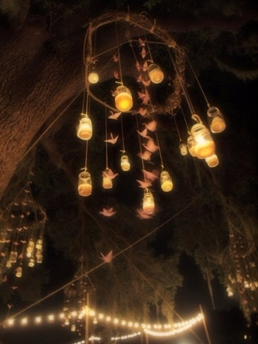 "thewhitedress:  ""They are mason jars hung from trees with candles in them. AMAZING!"""