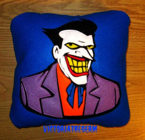 rudimentarymydear:  Custom order - Joker VictoriaTheGerm - Etsy - Facebook Fan Page   •Geekleetist: Um…some of you Mr. J fans will PEE over Rudi's new pillow!•