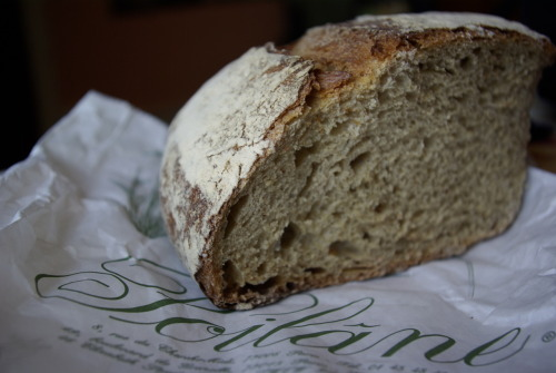 Pain Poilâne.  This is from the other formidable boulangerie we visited.  You may remember my attempt at a giant sourdough 100% (sifted) whole wheat loaf.  Mine was not nearly as lofty as this one.  The shop, tucked away on rue du Cherche-Midi, deep in the Left Bank, is really only meant to sell one kind of bread - the 2kg miche.  They have other bread products but they're really just purely decorative.  We bought a quarter of a loaf, and ate it over 2 days.