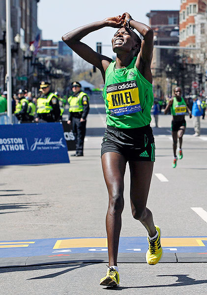 thebeautyofsports:  Caroline Kilel is overcome by emotion and exhaustion shortly after winning the women's division of the 115th Boston Marathon. (via The 115th Boston Marathon - Photos - SI.com)