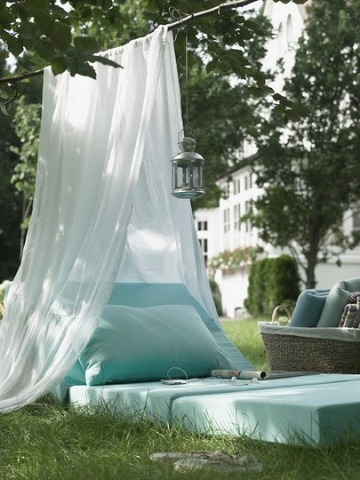 "truebluemeandyou:  justbesplendid:  backyard escape  Truebluemeandyou: DIY Inspiration: Apartment Therapy writes: ""Throw together a few outdoor cushions, drape some mosquito netting over a branch, string up an inexpensive Moroccan lantern…""  Who knew something this beautiful and serene could be so simple to throw together. This is exactly what I wanted to do all last week when it was 25 degrees out all week. Oh, student apartment woes…"