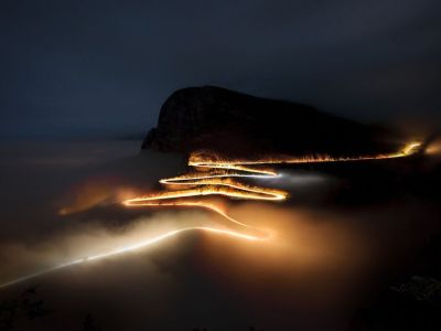 "ixplosion:    Serra da Leba, Angola Photograph by Kostadin Luchansky, Your Shot This is Serra da Leba, a landmark in Angola. It has been one of the country's postcard images for decades, but all shots were taken by day. I needed something different. I decided to try a night shot, but it seemed impossible: pitch black, foggy, an altitude of 1,800 meters (5,000 feet). My Nikon can stay open as long as 60 seconds max. But a car takes a few minutes to climb and descend and complete the ""drawing."" The fog was blocking! Suddenly the fog cleared, a car went down, another went up, and they met in the middle in under 60 seconds. Painting done. (This photo and caption were submitted to Your Shot.)"
