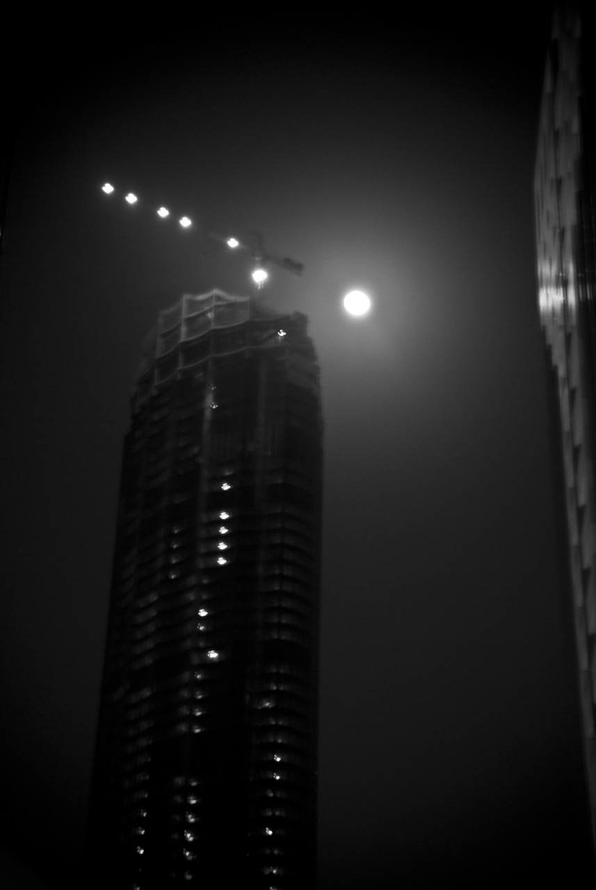 Moonlit construction <3 What I'd give to be at the top floor. Not very clear, but I didn't have a tripod by me :( So I did what I could. - JoseRomuald