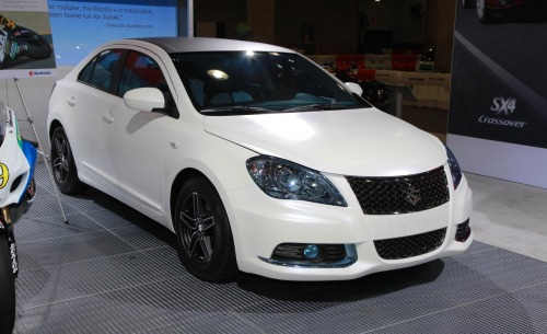 "Suzuki Kizashi EcoCharge Concept ""Our basic concept was to attain substantial gains in fuel  economy without the traditional sacrifices in drivability required with  today's midsize hybrid sedans. The proof of our concept is that the  Kizashi EcoCharge has the capability to deliver a 25 percent fuel  economy gain in real-world driving through an electric charge to the  powertrain system while still retaining the production Kizashi's dynamic  handling and braking advantages that make it a standout category  performer."" - Steve Younan, director of  automotive marketing and product planning for American Suzuki Motor  Corporation"