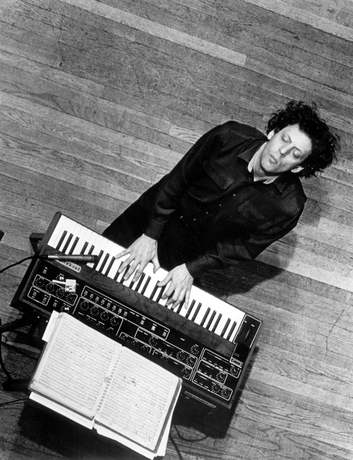 The young Philip Glass, vintage synth, wood floor, musical ecstasy. There's so much to love here.