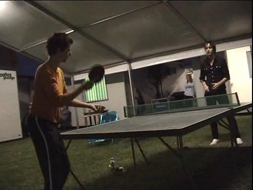 Matthew Bellamy and Julian Casablancas playing ping pong  What a strange, surreal life rock stars lead.