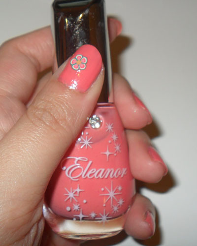 Peach Nails with a Fimo Blossom —- Sorry, this is another bargain bin find without a name or number. But I'm sure you can find a similar shade from most nail brands. It's just a bright, creamy peach-pink on which I stuck a little teal and pink blossom.