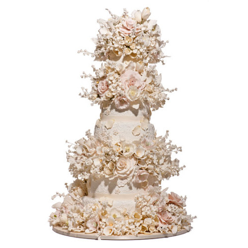This beautiful flowery cake feels very French to me! This cake has the grandiosity of Versailles Palace, n'est pas? (via New York Magazine)