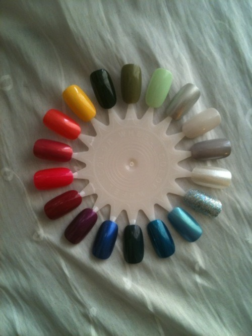 "its so pretty! ^^ my first color wheel :D  Polishes: (Lightest to darkest)  OPI Happy Anniversary OPI ""Sheer"" Your Toys OPI Moon over Mumbai Precision Silver  OPI Gargantuan Green Grape American Apparel Army Jacket American Apparel Hunter Sally Hansen Lightening OPI Bright Lights Big Color OPI Senorita Rose-alita Jade One on One OPI Miami Beet OPI Plugged-in Plum OPI Blue My Mind OPI Ski Teal We Drop OPI Yodel Me on My Cell Color Craze Blue OPI Simmer & Shimmer  Wheew, that's a lot of colors…"