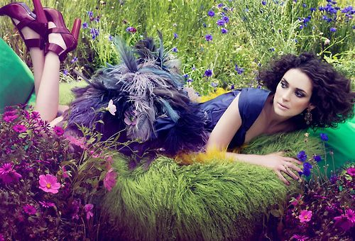 because who wouldn't want to lay on flowers while in a feather skirt? :) I love the contrast of colors in this photo.