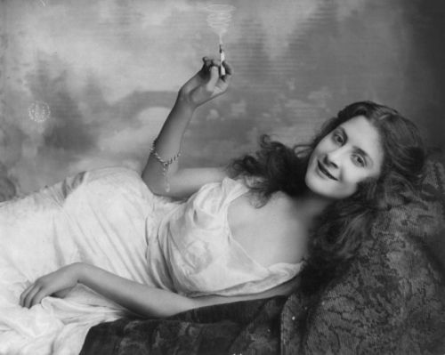 "Young woman lying on sofa & holding burning cigarette  by Fitz W. Guerin, 1903 Very few women smoked at the turn of the century, because smoking was seen as immoral and a sign of bad character. This was very frustrating to tobacco companies. As George Washington Hill, president of American Tobacco said in 1928, convincing women to smoke ""will be like opening a new gold mine in our front yard."" But, tobacco companies dared not advertise to women, for fear of sparking public outcry. As the 20th century progressed, women began breaking down social and legal barriers. By the late 1920s, tobacco companies decided the time was ripe to take advantage of women's progress. In 1928, American Tobacco launched its ""Reach for a Lucky Instead of a Sweet"" campaign to promote Lucky Strikes cigarettes. The ads, which capitalized on the ""flapper era's"" new penchant for slenderness, were among the most successful marketing campaigns in history"