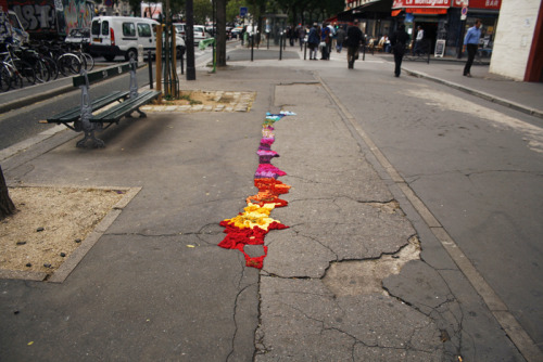 Project Pothole Artist Juliana Santacruz Herrera has taken to the streets of Paris to repair unsightly potholes and cracks with braids and braids of colorful yarn. Reblogged via Honestly WTF.
