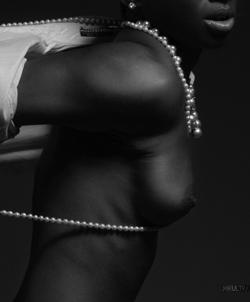 The Breast in Black and White with Pearls