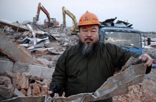 Like many artists, Ai Weiwei enjoys provoking. It isn't just his finger-to-the-Chinese-government images that he has become known for but also how he does it: his obsessive-compulsive documentation of himself in photos, blogs, tweets, and rants into a digital recorder. In a country obsessed with walls, he is a living challenge to the political system.  This has made Ai an important Chinese artist, but also a dream dissident.  Ian Johnson, China Misunderstood: Did We Contribute to Ai Weiwei's Arrest?  Photo: Ai Weiwei holding debris from his newly built Shanghai studio after it was demolished by the authorities, January 11, 2011 (STR/AFP/Getty Images)