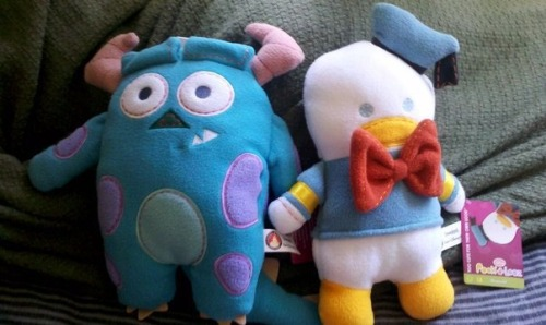 "The new additions to our ""Pook-A-Looz Family""  Sulley & Donald   We got them last night just as we were leaving the park.. They were 40% off plus my 20% off from my AP so they ended up only being $6.50 each!!! I'm so glad I go these two little guys.. they are ADORABLE! So far I've got Fantasia Mickey, Goofy [my sister's], Donald, & Sulley. All I need is PETER PAN & I think I might be set.. maybe."