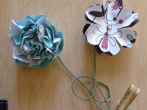 I have seen many paper flowers recently. My crafty friend Elizabeth made these for my birthday. So you could call this a guest blog post. I think these are completely adorable! I will have to get specific instructions about how to make the ones she made, but check out this Martha Stewart link to all of her different paper flowers. There are a lot of different options for paper flowers from the crafting queen herself.