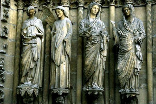 Visitation, Reims Cathedral 1230. Classical influence in drapery. Contrapposto. Heads look Roman. Mary announces her pregnancy. Columns are behind.