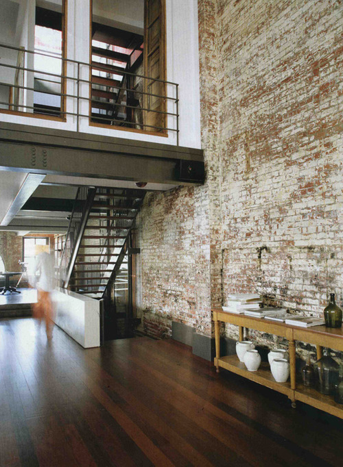 i love exposed bricks inside of a house/apartment.