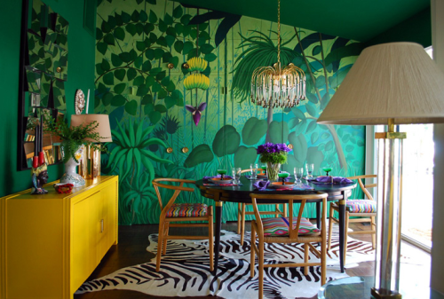 The sickest dining room ever with the neatest pairings of vintage, vibrant colors, and animal print.  LOVE! Designed by Molly Luetkemeyer