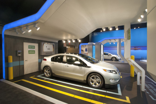 Chevy's Volt Life Scenarios at the 2011 NY Auto Show show how the cars can be re-charged in residential or commercial parking bays; in an environment that usually aims to 'wow' and entertain, the stands relate electrical cars on-show to people's (future) daily lives - clever. via PSFK