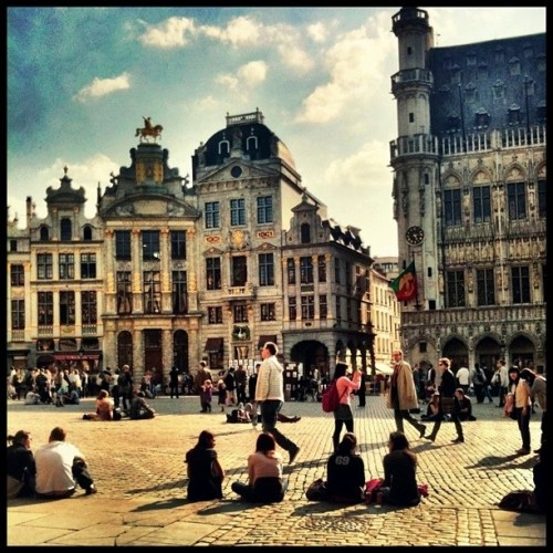 People basking in the sun on the Grand Place (Taken with Instagram at Brussels)