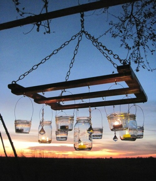 thelifesomewhatartistic:  Outdoor mason jar chandelier.  Note: I'm reblogging a post that appears to have been published without linking to a specific Etsy shop or item; instead, it links only to the general Etsy.com site. As a result, we readers have nothing on which to click to learn who made the chandelier! I took the time to search on Google for jar lights and came across this item from treasureagain. I think it's the same chandelier as the one pictured above. Please correct me if I'm wrong in giving credit to treasureagain on Etsy! —Molly of Unconsumption