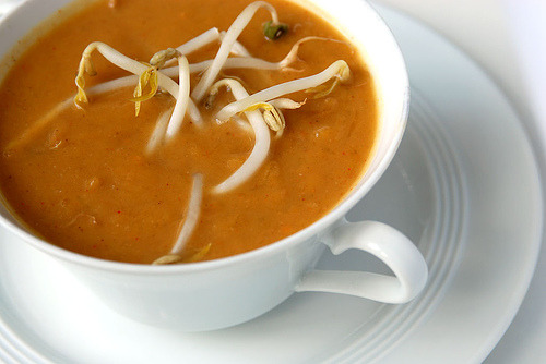 Spicy Peanut soup  INGREDIENTS:  1 cup peanut butter 2 tbs. oil 1/2 teaspoon cayenne pepper 1 tbs. fresh ginger, grated 1 stalk celery, chopped (marinate in vinegar, red chili pepper flakes optional) 1 liter vegetable jain broth 1 tbs. pure tomato paste splash tabasco pinch salt 1 tbs. sugar  METHOD:  1. Heat the oil in a sauce pan. Add the chopped celery and saute until glassy. 2. Add the vegetable bouillon and the peanut butter and stir well to mix. 3. Add the tomato paste and spices and allow to simmer until warm and well blended. 4. Season to taste with salt, Tabasco and a pinch of sugar.  Original recipe via trinigourmet/adapted to the Jain way by YummyVegan.