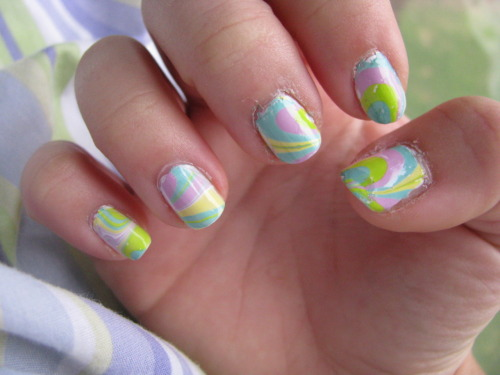 Easter Egg nails, part 1! A water marble - I'm getting a little better at them!  Orly's White Out is the base color, and the white in the marble. Also featured are China Glaze's For Audrey, pa's A34, Orly's Lolipop, and Orly's Lemonade.