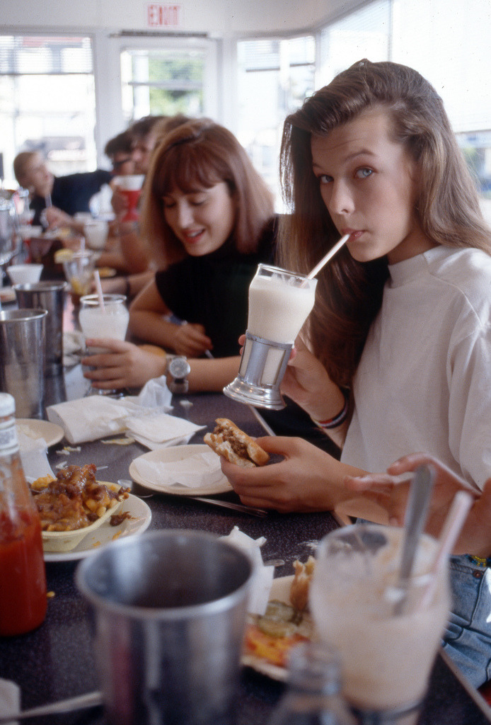 Milla Jovovich eating a Cheeseburger, Chocolate Malt and Chili Cheese Fries at Johnny Rockets, on Melrose in Hollywood. models never eat junk food..