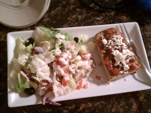 Greek Salad and Bruschetta BruschettaIngredients:  1 Large Tomato, chopped1 Clove of Garlic, minced2-3 Tbsp. of Basil 1 Tbsp. of Olive Oil 1 Teaspoon of Balsamic Vinegar Salt and Pepper to taste Feta Cheese 1 Baguette of French Bread (or similar bread) How to Make It:1. Before chopping up tomatoes, gut the insides and set aside. Chop up the rest into small pieces. Mix the tomatoes,  garlic, basil, vinegar, salt, pepper and olive oil.2. Preheat the oven to 450 degrees. Lightly coat the top of the bread with olive oil (using a brush) and place the bread oil side down on a cookie sheet. Bake the bread (on the top rack) for about 5-6 minutes. Once finished, take the bread out and place on the plate oil side up.3. Cover the top of the bread with tomato mix and then sprinkle with feta cheese. Greek SaladIngredients: Romaine Lettuce Sliced Red Beets (I use canned) Small Black Olives (pitted)Cucumber Red Onion Tomato Feta Cheese Greek Dressing How To Make It:1. Chop up all veggies, mix together in a bowl, add dressing and Feta cheese.