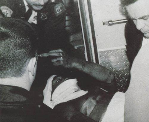 Tupac holding his middle finger high after being shot.  One of the dopest photo's i ever seen.  the realest. RIP.